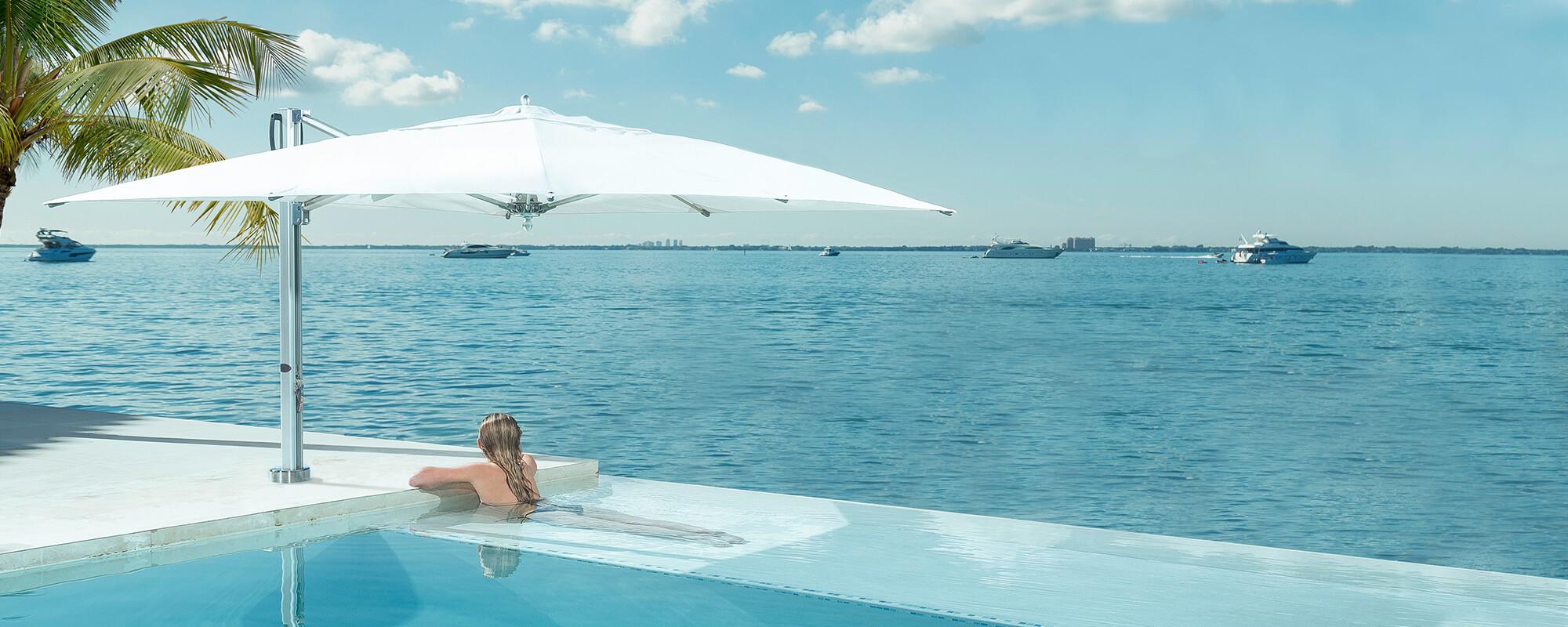 pool side swim under cantilever bay master umbrellas. Black Bedroom Furniture Sets. Home Design Ideas